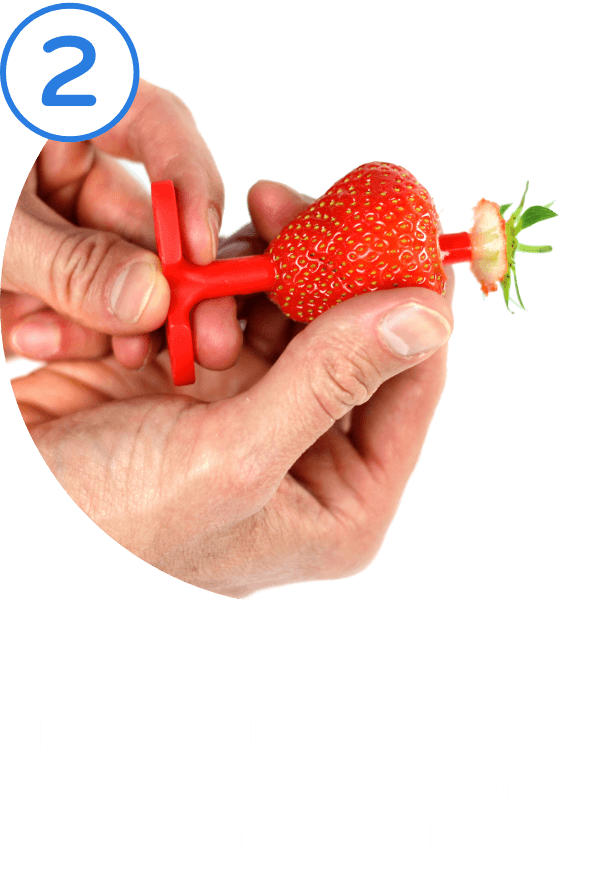 2. Push Through. Drive the huller up through the centre of the strawberry until the leaf is removed.