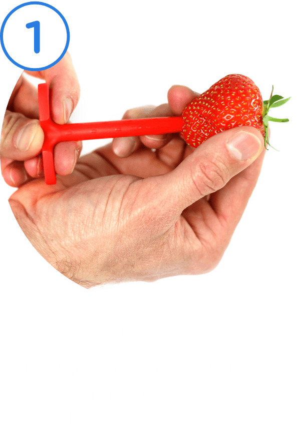 1. Line Up. Take a strawberry and line the huller centrally with the core at the base of the fruit.