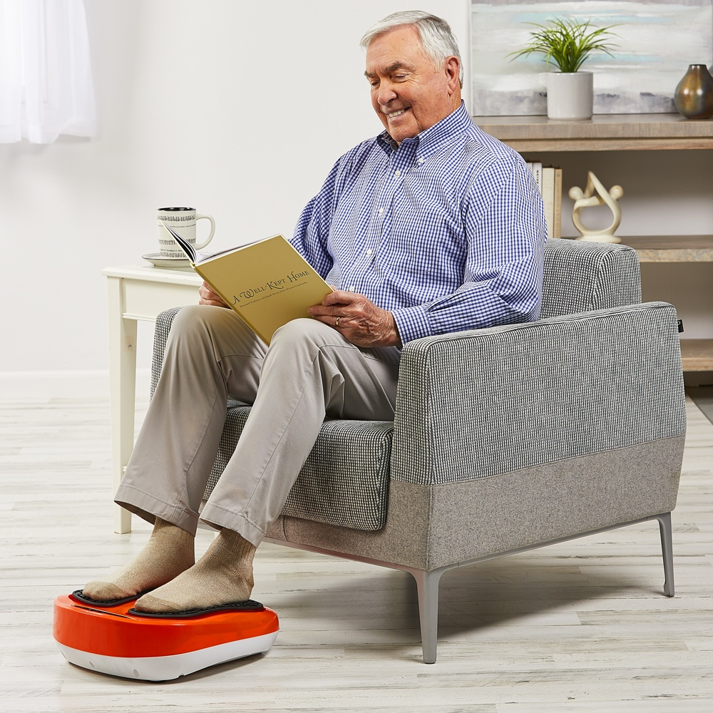 Man reading book while using PowerLegs