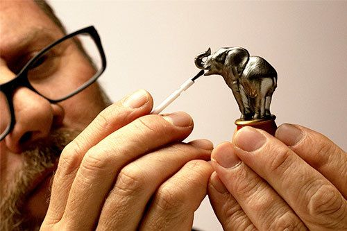 Man detailing a chess piece