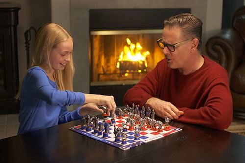 Daughter and Father playing 2020 Battle for the White House Chess Set