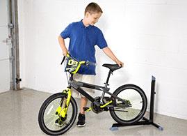 Boy backing his bike into the Bike Nook
