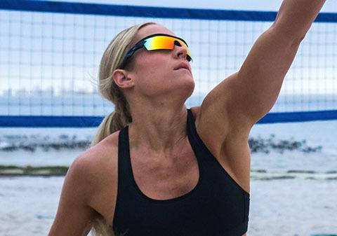 Woman wearing Battle Vision playing volleyball outside