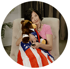 cozy flag blanket included inside of bear