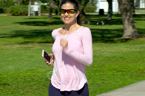 Woman jogging in park wearing Battle Vision