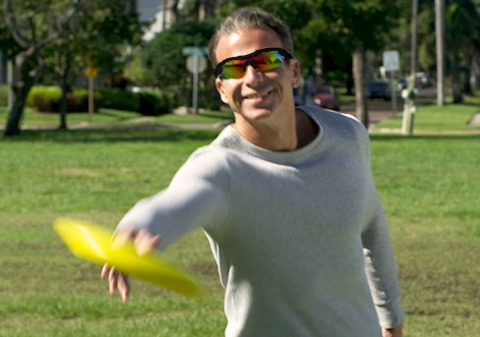Man wearing Battle Vision in park catching frisbee