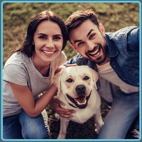 Happy couple and dog selfie