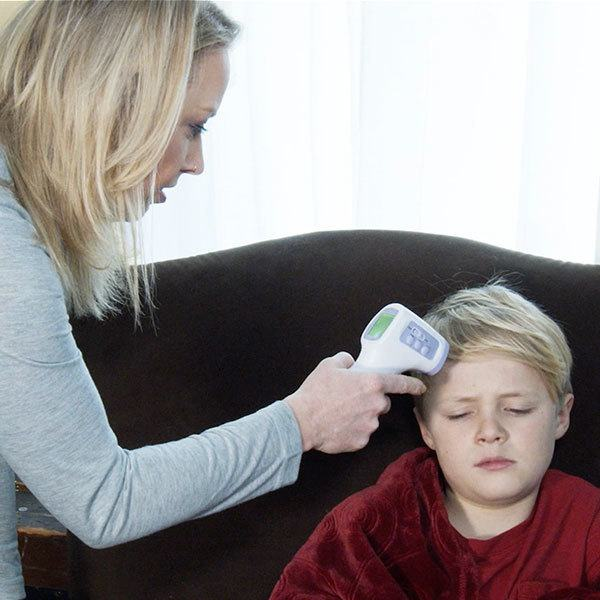 just point and click - woman takes boy's temperature