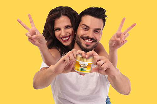 Happy couple holding Hempvana Gold pain cream jar