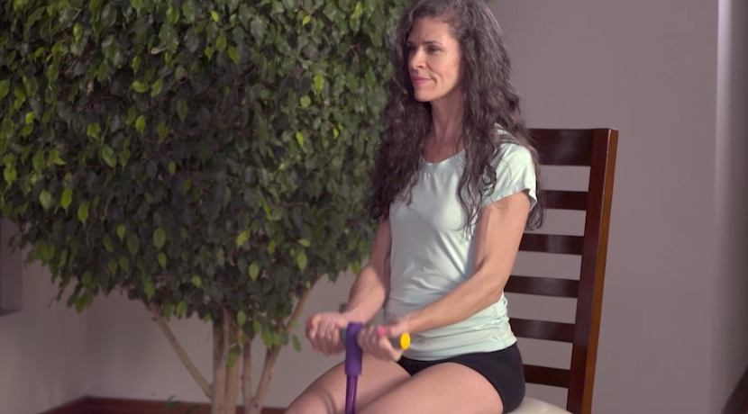 woman sitting in chair using ezcise