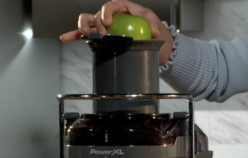 juicer with extra large chute - apple in chute