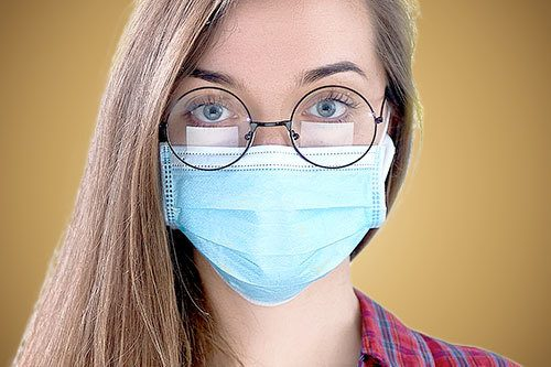 Woman wearing glasses and face mask