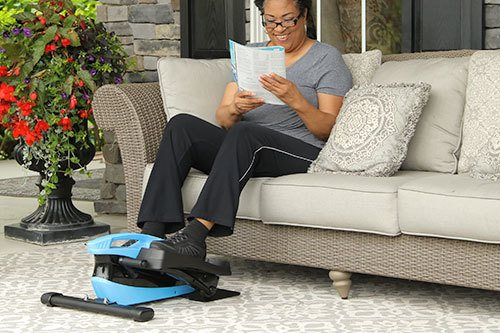 Woman using Blu Tiger on outdoor porch while reading