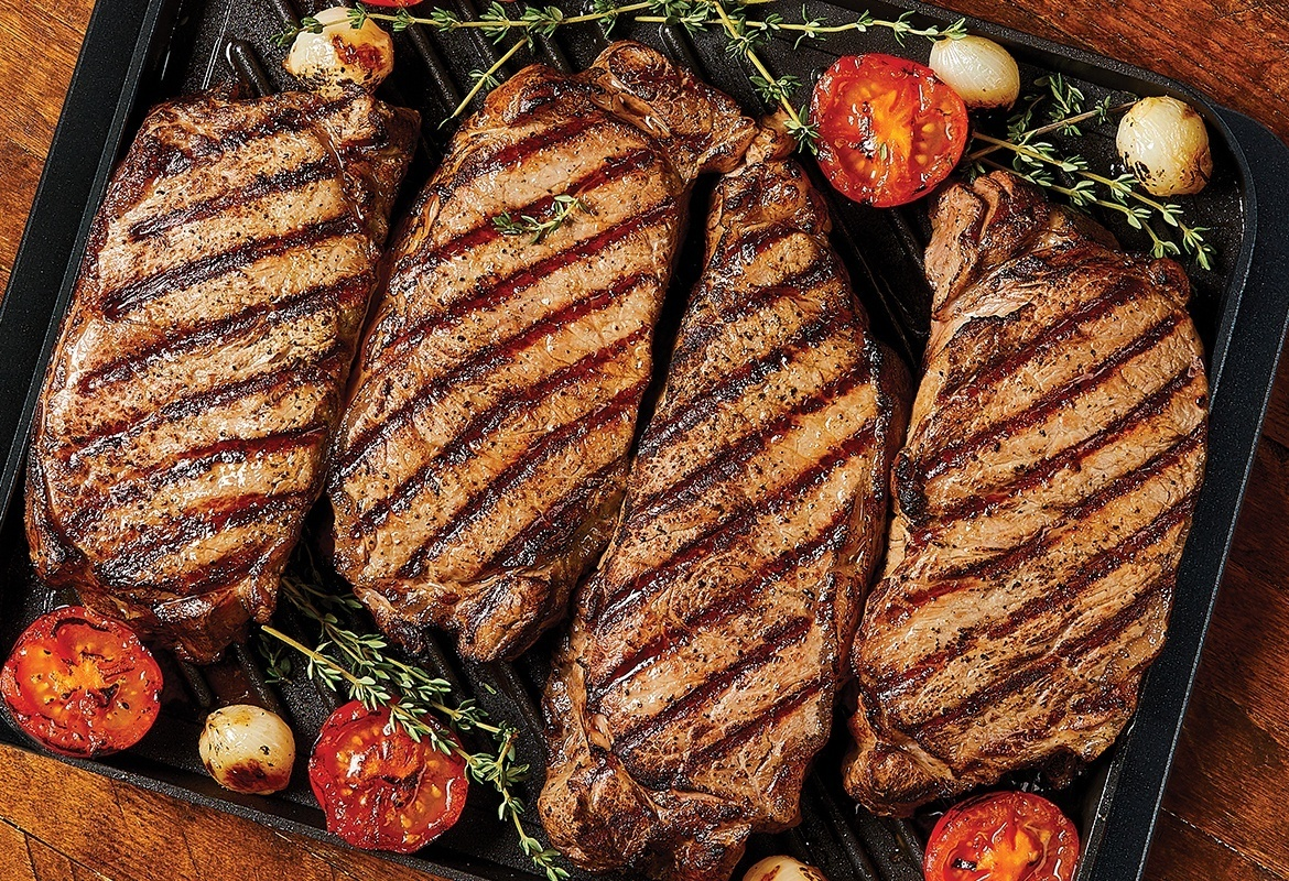 grilled steaks with grill marks on nonstick grill pan