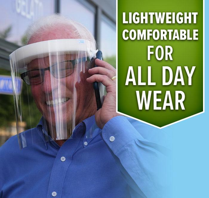 Elderly man wearing Fresh View Shield while talking on phone; Lightweight comfortable for all day wear