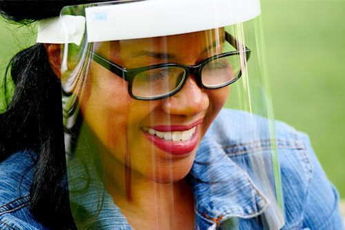 Woman wearing Fresh View Shield over glasses