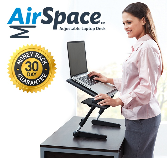 Woman standing at desk using Air Space Laptop Desk