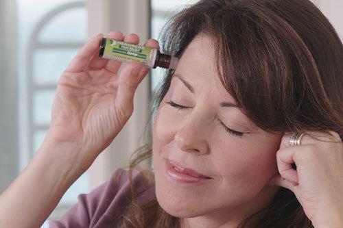 Woman applying Hempvana Headache