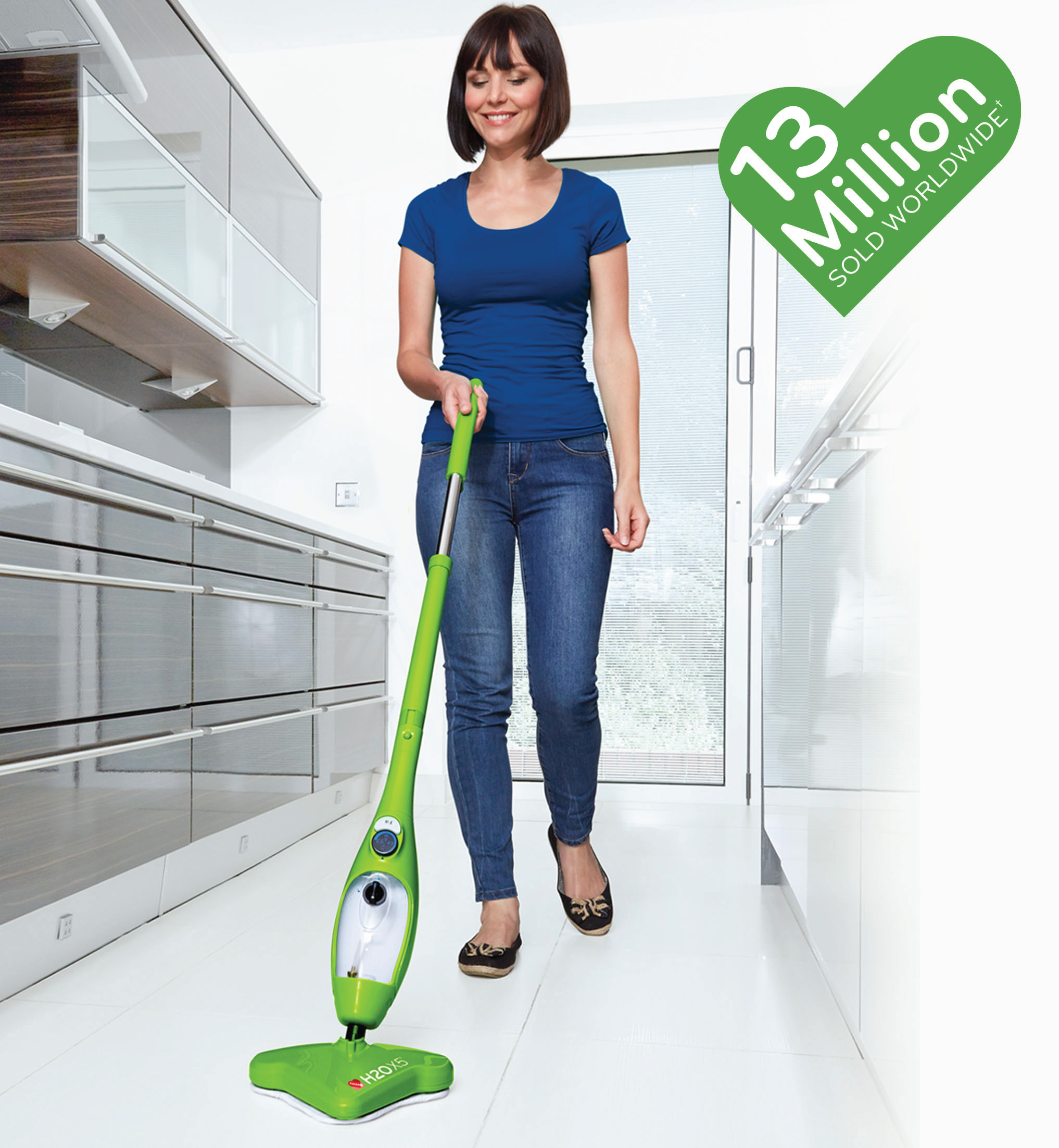 A woman cleaning the floor with a H2O X5