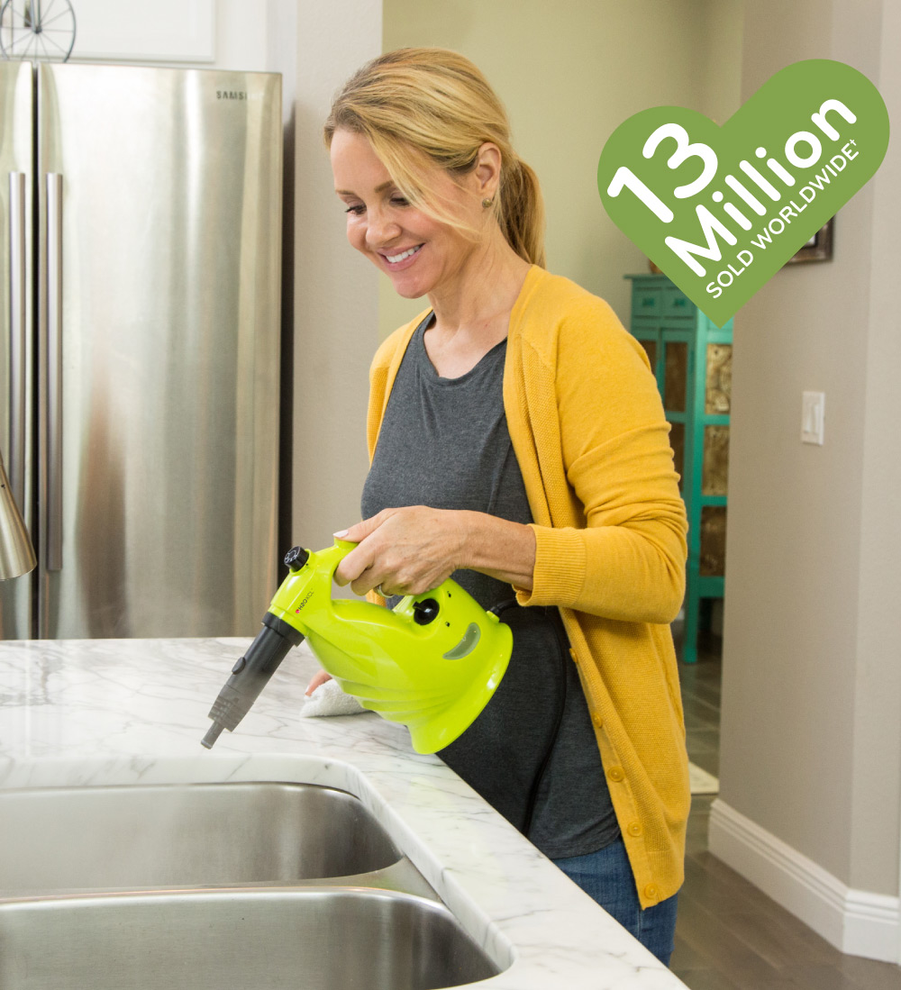 A lady cleaning the sink with XCL