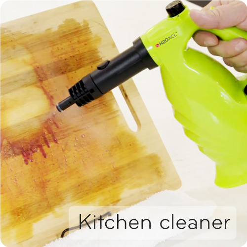 XCL cleaning a kitchen chopping board