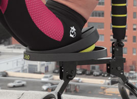 The seat tilting forward during a woman's workout